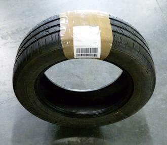 Prawidłowo zapakowana opona dla kuriera DHL - taśma
