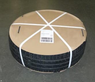 Prawidłowo zapakowana opona dla kuriera DHL - okrągły karton