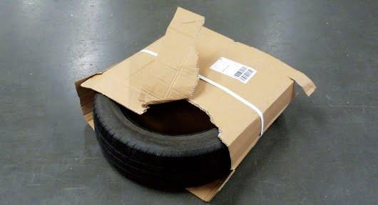 Źle zapakowana opona dla kuriera DHL